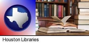 Houston, Texas - books on a library table and on library bookshelves