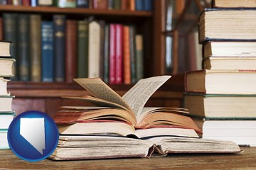 books on a library table and on library bookshelves - with Nevada icon