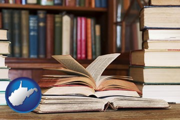 books on a library table and on library bookshelves - with West Virginia icon